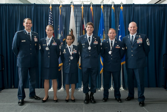 Lieutenant Gen. Stanley E. Clarke III, director of the ANG (left) and Chief Master Sgt. James W. Hotaling, command chief master sergeant of the ANG (far right), stand with the ANG outstanding Airmen of the Year during an All Call event Joint Base Andrews Md., Aug 6, 2015. The OAY winners are (left to right) Master Sgt. Sally J. Ford, Outstanding First Sergeant of the Year, Master Sergeant Maria Victoria R. Quitugua, Outstanding Senior NCO of the Year, Staff Sgt. Douglas P. Kechijian, Outstanding Non-Commissioned Officer of the Year and Senior Airman Jonathan R. Smail, Outstanding Airman of the Year. (Air National Guard photo by Master Sergeant Marvin. R. Preston, Released)