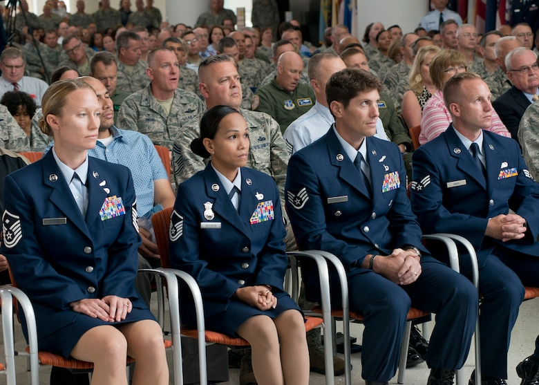 The Air National Guard 2015 Outstanding Airmen of the Year listen as Lieutenant Gen. Stanley E. Clarke III, director of the Air National Guard, addresses the audience during an All Call event at Joint Base Andrews Md., Aug 6, 2015. The OAY winners are (left to right) Master Sgt. Sally J. Ford, Outstanding First Sergeant of the Year, Master Sergeant Maria Victoria R. Quitugua, Outstanding Senior NCO of the Year, Staff Sgt. Douglas P. Kechijian, Outstanding Non-Commissioned Officer of the Year and Senior Airman Jonathan R. Smail, Outstanding Airman of the Year. (Air National Guard photo by Master Sergeant Marvin. R. Preston, Released)