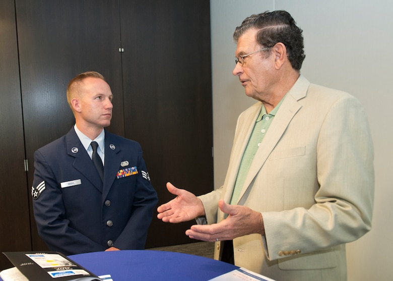 Senior Airman Jonathan R. Smail, Air National Guard 2015 Outstanding Airman of the Year, talks with retired Chief Master Sgt. Lynn E. Alexander, the second Senior Enlisted Advisor of the ANG, at the Air National Guard Readiness Center on Joint Base Andrews, Md., Aug. 6, 2015. Smail is a RF Transmissions Systems Journeyman with the Colorado ANG's 233rd Space Communications Squadron, based in Greeley, Colorado. Focus on the Force week gathers senior enlisted leaders to highlight the importance of professional development at all levels, receive feedback from junior enlisted Airmen, and tell the exceptional stories of ANG Airmen throughout the 50 states, territories, and the District of Columbia. (Air National Guard photo by Master Sergeant Marvin. R. Preston, Released)