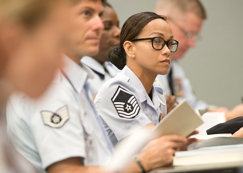 Master Sergeant Maria Victoria R. Quitugua, 2015 Air National Guard Outstanding Senior NCO of the Year, listens to a presentation by Chief Master Sgt. James W. Hotaling, command chief master sergeant of the Air National Guard, during the Chiefs Executive Course at the Air National Guard Readiness Center at Joint Base Andrews, Md., Aug. 3, 2015. Quitugua is a security forces Airman from the Guam Air National Guard's 254th Security Forces Squadron. (Air National Guard photo by Master Sgt. Marvin. R. Preston, Released)