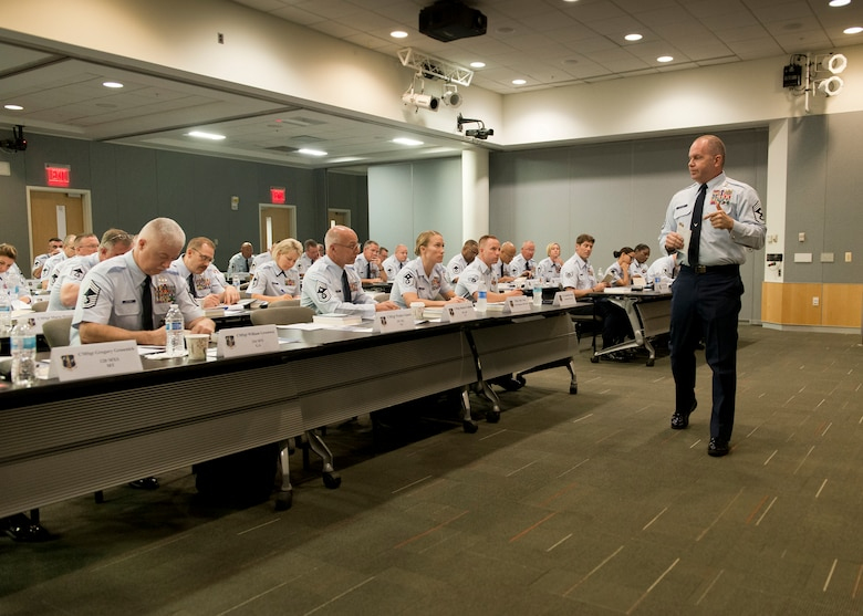 The Chief Master Sergeant of the Air National Guard, James W. Hotaling, addresses recently-promoted chief master sergeants during the Chief's Executive Course at the Air National Guard Readiness Center at Joint Base Andrews, Md., Aug. 3, 2015. Hotaling also used the opportunity to introduce the ANG Outstanding Airmen of the Year for 2015. The CEC provides recently promoted Chief Master Sergeants with a broad view of operations at a strategic level. (Air National Guard photo by Master Sgt. Marvin. R. Preston, Released)