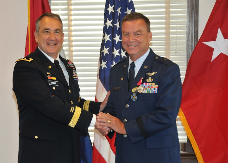 Maj. Gen. Steve Danner, adjutant general for the Missouri National Guard (l) stands beside Brig. Gen. David Newman of Pittsfield, Ill. who retires from the Missouri Air National Guard with 38 years of military service.  (U.S. Air National Guard photo by 2nd Lt. Sean Navarro)