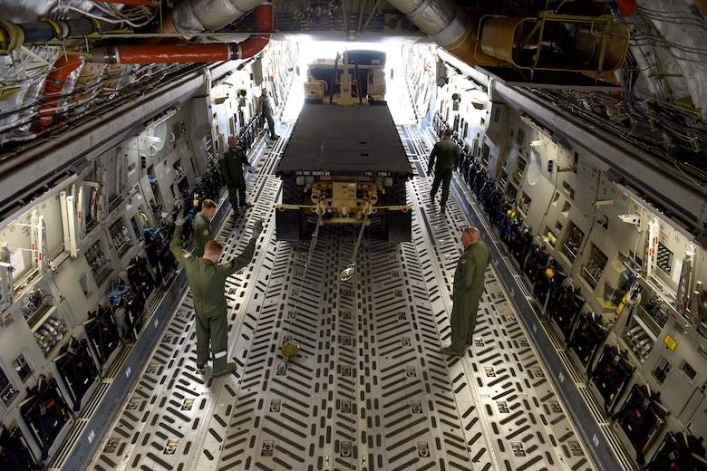 Airmen from the 89th Airlift Squadron load a vehicle into the cargo hold of a C-17 Globemaster III during joint multi-unit deployment training exercises June 6, 2016 at the 180th Fighter Wing in Swanton, Ohio. The 180th hosted 10 military and civilian agencies to foster joint teamwork and strengthen community partnerships by enriching interagency communication. (Air National Guard photo by SSgt Shane Hughes/Released)