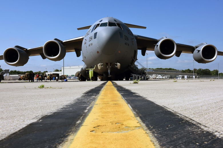 A C-17 Globemaster III sits on the runway at the 180th Fighter Wing in Swanton, Ohio during a joint C-17 deployment training exercise June 6, 2015. The 180th hosted 10 military and civilian agencies to foster joint teamwork and strengthen community partnerships by enriching interagency communication. (Air National Guard photo by SSgt Shane Hughes/Released)