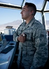 Airman 1st Class Cameron Cabrera, 57th Operations Support Squadron air traffic controller, talks to the pilot of a transient aircraft in the control tower on Nellis Air Force Base, Nev., Aug. 4, 2015. ATC Airmen direct aircraft on the ground and through controlled airspace, and can provide advisory services to aircraft in non-controlled airspace. (U.S. Air Force photo by Airman 1st Class Jake Carter)