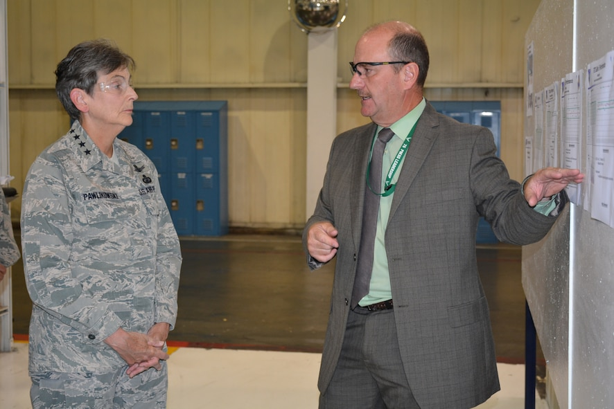 Tom Leinneweber, 545th Propulsion Maintenance Squadron director, goes over production statistics for the TF-33 engine line with Gen. Ellen M. Pawlikowski, Air Force Materiel Command commander, during a tour of the Tinker Aerospace Complex, Bldg. 9001, on Wednesday. General Pawlikowski's visit to Tinker Air Force Base was part of a multi-base immersion of the Air Force Sustainment Center. While here, she also visited the 72nd Air Base Wing, held an All Call for AFMC Airmen and was the guest speaker for a local community luncheon. More on the AFMC commander's AFSC immersion in next week's TTO.  (Air Force photo by Darren D. Heusel/Released)