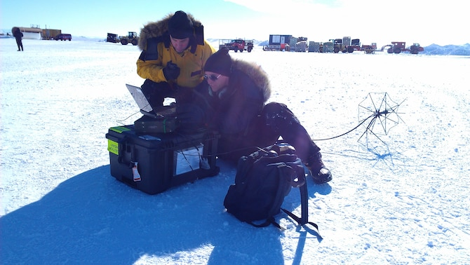 Members of an Air Force, Navy and Lockheed Martin team test a satellite communications system in Antarctica. The system is designed to provide communication capabilities in remote areas. (Air Force photo)