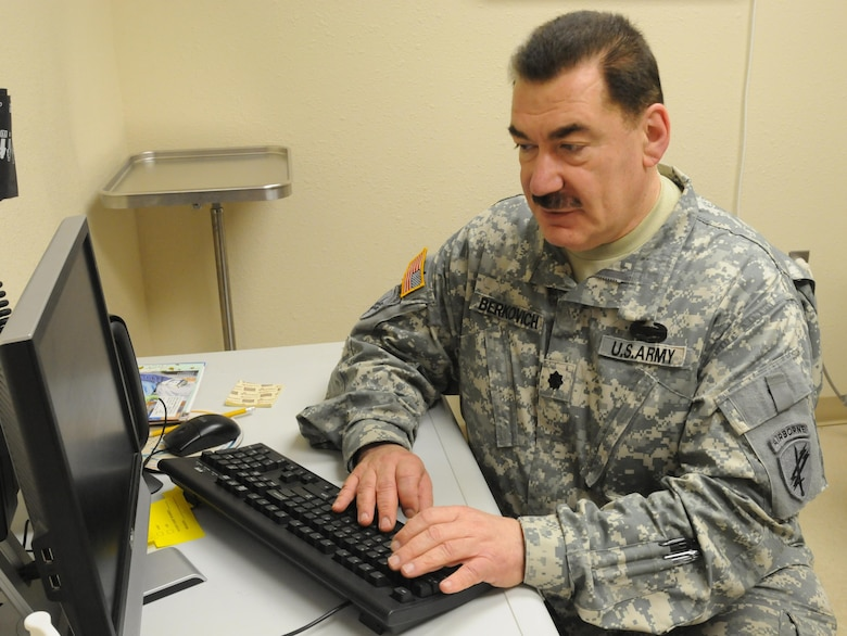 Army Reserve Lt. Col. Vladimir Berkovich, a medical doctor with chiropractic and acupuncture experience, and a member of the 7207th Medical Support Unit, Northeast Medical Area Readiness Support Group, Webster, N.Y., enters patient information on the computer while working at the Indian Health Service clinic in Lower Brule, S.D. Soldiers were sent to the reservation to provide necessary medical care to the Native American population in the area. (U.S. Army photo by Sgt. Beth Raney, 363rd Public Affairs Detachment/Released)