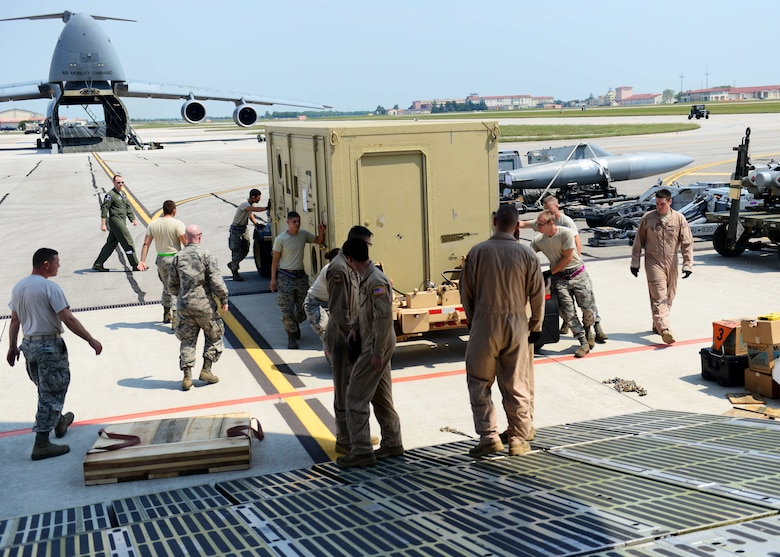 Airmen from the 436th Airlift Wing and 724th Air Mobility Squadron load cargo onto a C-5 Super Galaxy in support of Operation Inherent Resolve Aug. 8, 2015, at Aviano Air Base, Italy. This deployment coincides with Turkey's decision to host U.S. aircraft to conduct counter-ISIL operations. (U.S. Air Force photo by Airman 1st Class Deana Heitzman)