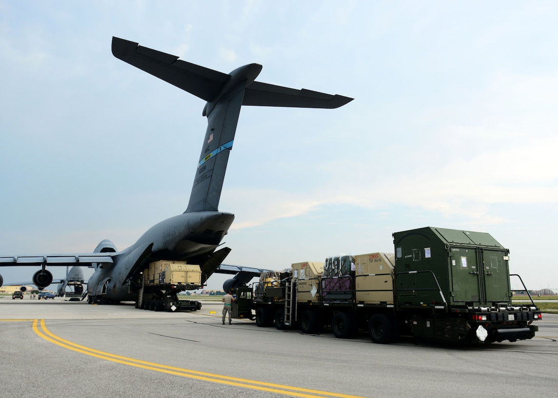 Cargo is loaded onto a C-5 Super Galaxy from the 436th Airlift Wing Aug. 8, 2015, at Aviano Air Base, Italy. The cargo will be delivered to Incirlik Air Base, Turkey, in support of Operation Inherent Resolve. This deployment coincides with Turkey's decision to host U.S. aircraft to conduct counter-ISIL operations. (U.S. Air Force photo by Airman 1st Class Deana Heitzman)