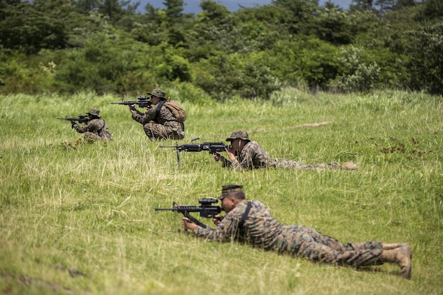 Marines with Combat Logistics Company 36 practice their fire and maneuver tactics during Exercise Dragon Fire 2015 at Combined Arms Training Center Camp Fuji, Japan, July 21. Service members participated in live-fire ranges, land navigation, and conducted convoy and recovery operations during the annual exercise to enhance their combat readiness.