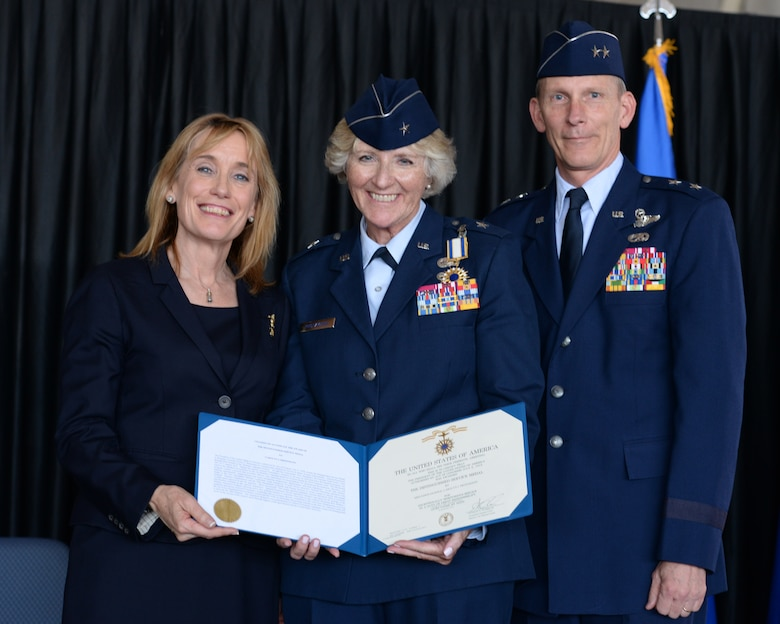 New Hampshire Gov. Maggie Hassan, Brig. Gen. (Ret.) Carolyn J. Protzmann, and the Adjutant General, New Hampshire National Guard Maj. Gen. William N. Reddel III pose for a  photo during Protzmann's retirement  ceremony at Pease Air National Base, N.H., on Aug. 9, 2015. Protzmann retired from the NHANG after 36 years of military service. Brig. Gen. Paul Hutchinson assumed command of the NHANG from Protzmann.  (U.S. Air National Guard photo by Staff Sgt. Curtis J. Lenz)