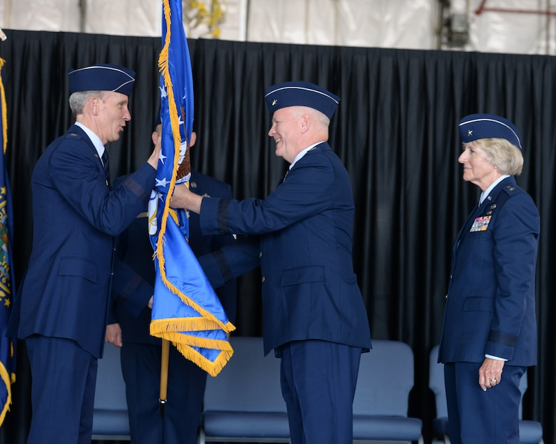 Brig. Gen. Paul Hutchinson receives a guidon from the Adjutant General, New Hampshire National Guard Maj. Gen. William N. Reddel III during a ceremony at Pease Air National Guard Base, N.H., on Aug. 9, 2015. Hutchinson assumed command of the NHANG from Brig. Gen. Carolyn J. Protzmann. (U.S. Air National Guard photo by Staff Sgt. Curtis J. Lenz)