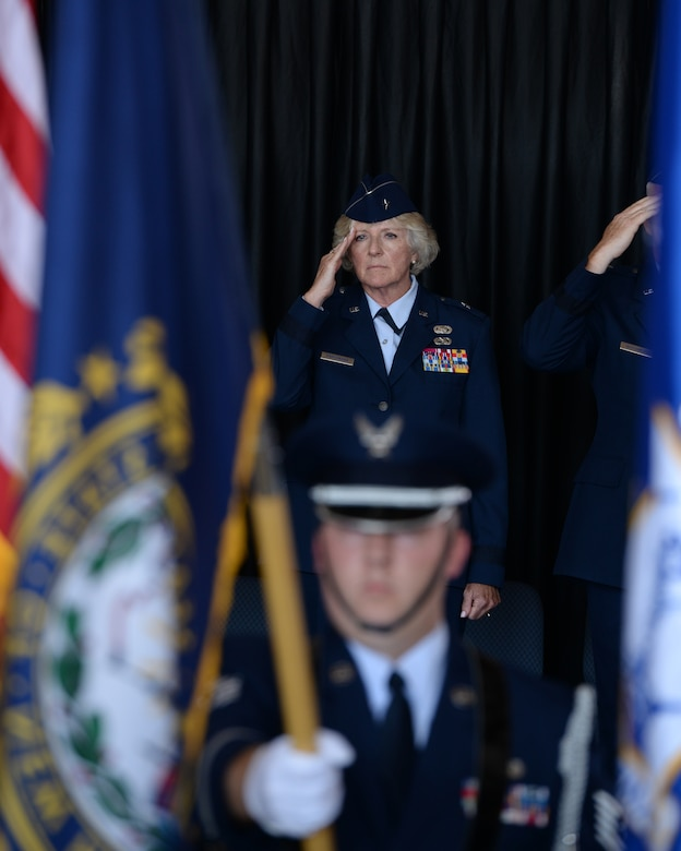 Brig. Gen. Carolyn J. Protzmann, commander New Hampshire Air National Guard renders a salute to members of the NHANG during her retirement ceremony at Pease Air National Guard Base, N.H., Aug. 9, 2015.  Protzmann retired from the NHANG after 36 years of military service. Brig. Gen. Paul Hutchinson assumed command of the NHANG from Protzmann. (U.S. Air National Guard photo by Staff Sgt. Curtis J. Lenz)