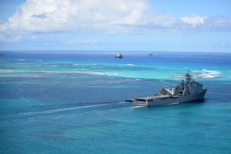 The USS Ashland sails along the coast of Saipan Aug. 9, 2015. The 48 square mile island was battered by Typhoon Soudelor Aug. 2, as the powerful storm made its way across the Pacific. The USS Ashland arrived to the island Aug. 7 to assist in storm recovery efforts. Numerous agencies are contributing to the relief effort including service members from the 36th Contingency Response Group, Helicopter Sea Combat Squadron Two Five and Marine Medium Tiltrotor Squadron 265 (Reinforced), 31st Marine Expeditionary Unit. (U.S. Air Force photo by Senior Airman Joshua Smoot/Released)