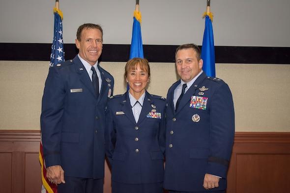 Col. Malia Spranger (center), HQ RIO Detachment 6 commander, and her husband, Lt. Col. Kurt Spranger (left), retired July 17. Maj. Gen Thomas J. Sharpy (right) presided over the ceremony.