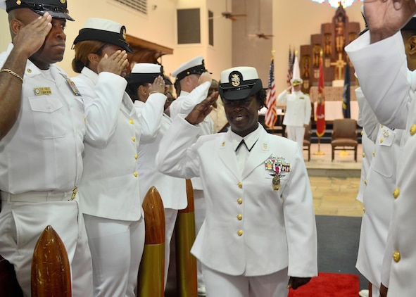 Naval Hospital Jacksonville Command Master Chief Bennora Simmons is piped ashore for the last time following her retirement ceremony at All Saints Chapel aboard Naval Air Station Jacksonville, Fla. Simmons is retiring after 30 years of naval service.