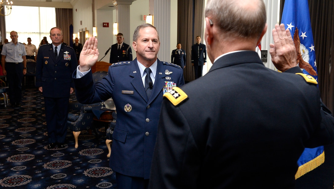 """Gen. David L. Goldfein is given the oath of office by Chairman of the Joint Chiefs of Staff Gen. Martin Edward """"Marty"""" Dempsey during his promotion ceremony Aug. 6, 2015, in Washington, D.C. Goldfein will become the Air Force's 38th vice chief of staff, and most recently served as the director of the Joint Staff. (U.S. Air Force photo/Scott M. Ash)"""