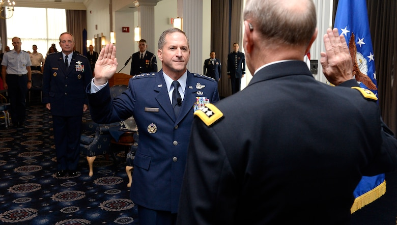 "Gen. David L. Goldfein is given the oath of office by Chairman of the Joint Chiefs of Staff Gen. Martin Edward ""Marty"" Dempsey during his promotion ceremony Aug. 6, 2015, in Washington, D.C. Goldfein will become the Air Force's 38th vice chief of staff, and most recently served as the director of the Joint Staff. (U.S. Air Force photo/Scott M. Ash)"