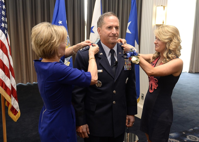 The rank of general is pinned on Gen. David L. Goldfein by his wife, Dawn, and daughter, Diana Glass, during his promotion ceremony Aug. 6, 2015, in Washington, D.C. Goldfein's promotion makes him the Air Force's 38th vice chief of staff. (U.S. Air Force photo/Scott M. Ash)