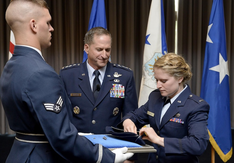 The rank of general is pinned on David L. Goldfein's flight cap by his daughter, 1st Lt. Danielle Fleming, during his promotion ceremony Aug. 6, 2015, in Washington, D.C. Goldfein's promotion makes him the Air Force's 38th vice chief of staff.  (U.S. Air Force photo/Scott M. Ash)