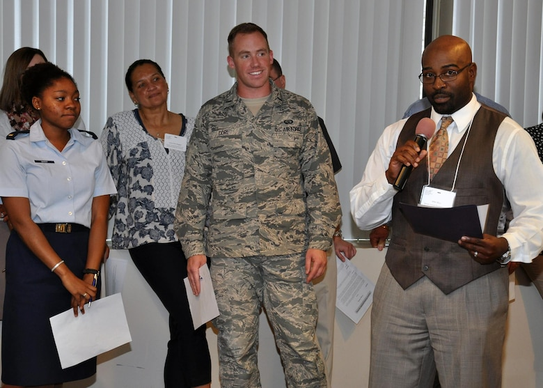 Allen Blair, a sexual assault response coordinator at Joint Base San Antonio-Randolph, Texas, provides his team's feedback on the best approaches for communicating with leaders during a five-day SARC annual refresher course at the National Conference Center in Leesburg, Va., Aug. 5, 2015. Nearly 130 SARCs from across the Air Force attended the training, which included lessons on prevention, policy, training and leadership interaction. (U.S. Air Force photo/Tech. Sgt. Bryan Franks)