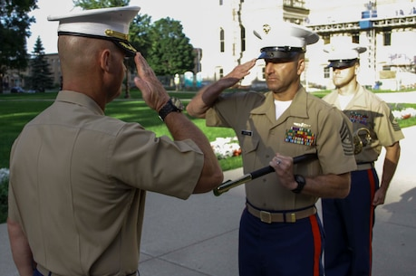 Sgt. Maj. Benny Benton, middle, relinquished his post as Recruiting Station Lansing sergeant major to Sgt. Maj. Kevin Bowman, right, during a relief and appointment ceremony upon the lawn of the Lansing, Mich., capitol building, July 19, 2015. Bowman said he is confident he has the ability to lead RS Lansing and the recruiters now under his charge, though it will be tough to fill Benton's shoes.