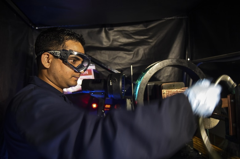 Airman 1st Class Raju Subedi, 1st Special Operations Equipment Maintenance Squadron non-destructive inspection apprentice, inspects a test object on Hurlburt Field, Fla., July 21, 2015. The NDI flight is responsible for detecting the smallest imperfections, wear and cracks on aircraft as well as aerospace ground equipment. (U.S. Air Force photo/Senior Airman Christopher Callaway)