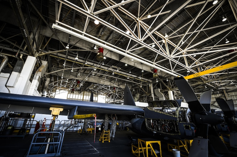 Airmen with the 1st Special Operations Equipment Maintenance Squadron non-destructive inspection flight examine a C-130 wing at the Eason Hangar on Hurlburt Field, Fla., July 20, 2015. Airmen inspect multiple locations of the aircraft, checking for flaws and cracks that could be dangerous if left undetected. (U.S. Air Force photo by Senior Airman Christopher Callaway)