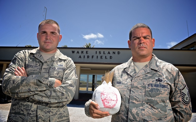 Tech. Sgt. Joshua Reitz, left, and Master Sgt. Yusef Saad, both contracting representatives with Detachment 1, PACAF Regional Support Center, stand in front of the passenger terminal at Wake Island Airfield, July 21, 2015. A small team with four Airmen of Det. 1 supervises contractor operations and ensures mission success on the remote atoll in the Pacific. (U.S. Air Force photo by Staff Sgt. Alexander W. Riedel/Released)