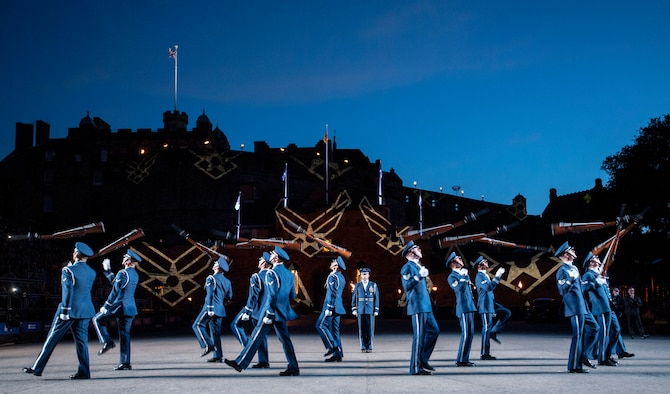 The United States Air Force Honor Guard Drill Team poses for a group photo after performing at the Royal Edinburgh Military Tattoo on the Esplanade of the Edinburgh Castle in Edinburgh, Scotland Aug. 6, 2015. A 20-member group of the Honor Guard Drill Team traveled to the United Kingdom to represent the USAF and the Department of Defense as the only branch of military service from the U.S. performing in the tattoo. (U.S. Air Force photo/Staff Sgt. Nichelle Anderson/Released)