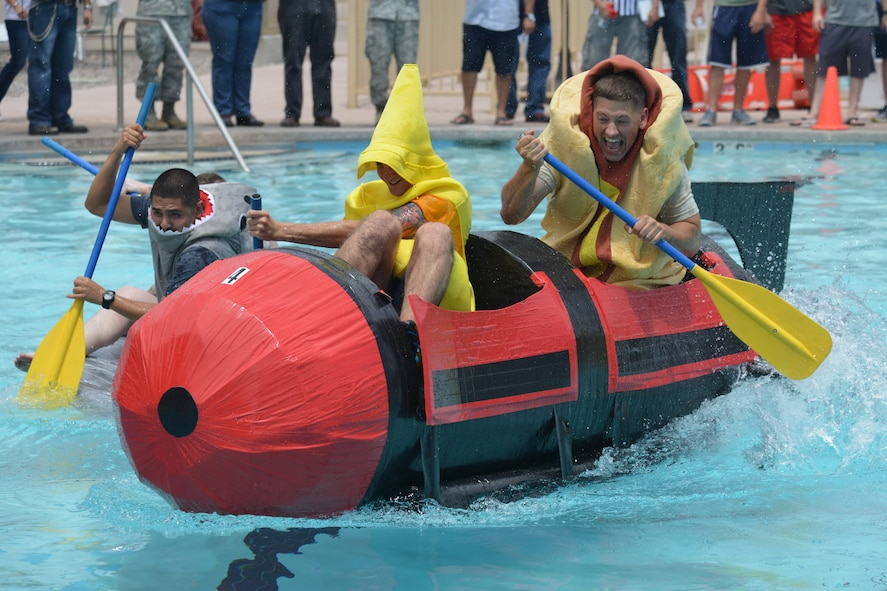 Eighteen teams competed in Kirtland's annual Battle of the Battleships Aug 7 at the Mountain View Club pool.  Teams raced boats made only of cardboard and duct tape. (Photo by Ken Moore)