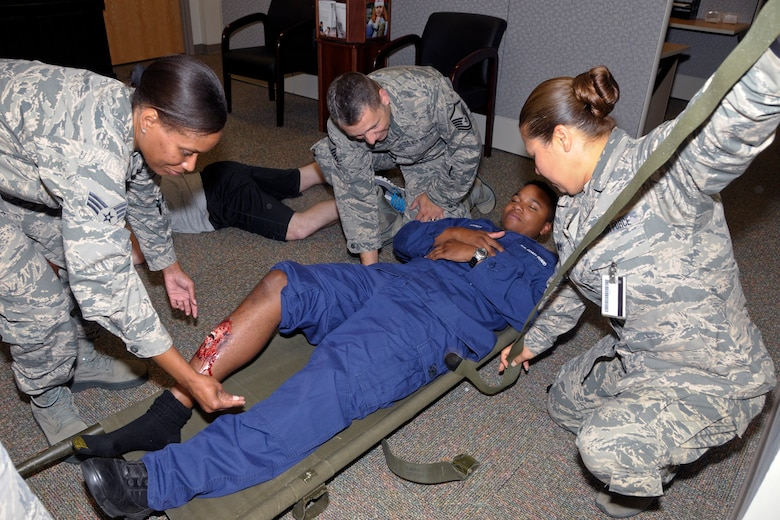 Medical, security and other personnel from the Michigan Air National Guard's 127th Wing, Coast Guard Air Station Detroit and other organizations participate in a mass casualty and active shooter exercise Friday, Aug. 7, 2015, at Selfridge Air National Guard Base, Mich. (U.S. Air National Guard photo by Brittani Baisden/Released)