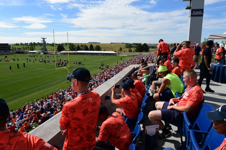 Military members watch the Denver Broncos training camp practice after participating in the military combine Aug. 7, 2015, at the Denver Broncos Headquarters Facility at Dove Valley in Denver.  The combine consisted of drills similar to the ones prospective National Football League players are expected to complete during the NFL combine held in Indianapolis before the NFL draft. All participants were also treated to a viewing of the Broncos' Friday morning practice and a visit from Broncos' players as well as the head coach. (U.S. Air Force photo by Airman 1st Class Luke W. Nowakowski/Released)