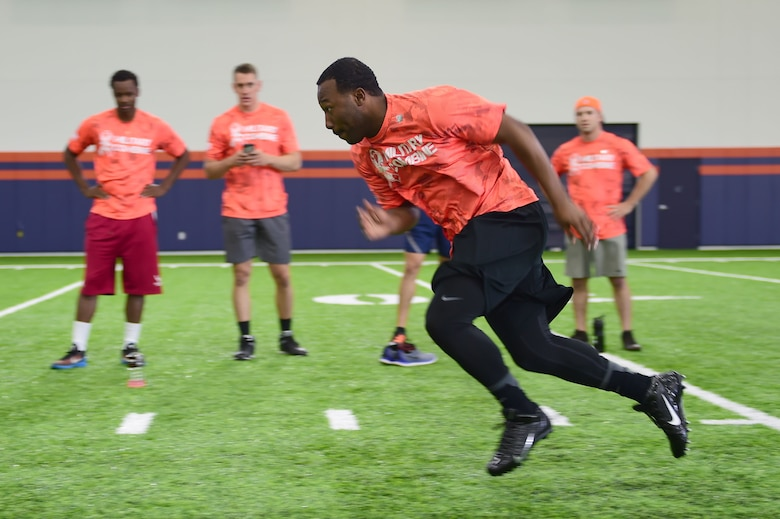 Senior Airman James Lampley, 460th Force Support Squadron career development technician, accelerates at the start of the shuttle drill portion on the military combine hosted by the Denver Broncos and United Services Automotive Association Aug. 7, 2015, at Denver Broncos Headquarters Facility at Dove Valley in Denver. The combine consisted of drills similar to the ones prospective National Football League players are expected to complete during the NFL combine held in Indianapolis before the NFL draft. All participants were also treated to a viewing of the Broncos' Friday morning practice and a visit from Broncos players, as well as the head coach. (U.S. Air Force photo by Airman 1st Class Luke W. Nowakowski/Released)