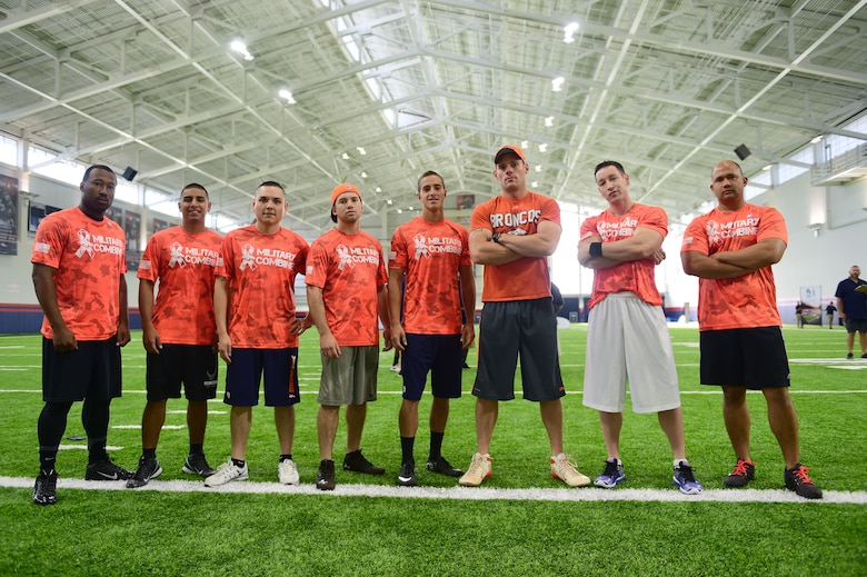 Team Buckley members stand ready to take on the military combine hosted by the Denver Broncos organization and United Services Automotive Association Aug. 7, 2015, at the Denver Broncos Headquarters Facility at Dove Valley in Denver. The combine consisted of drills similar to the ones prospective National Football League players are expected to complete during the NFL combine held in Indianapolis before the NFL draft. All participants were also treated to a viewing of the Broncos' Friday morning practice and a visit from Broncos players, as well as the head coach. (U.S. Air Force photo by Airman 1st Class Luke W. Nowakowski/Released)