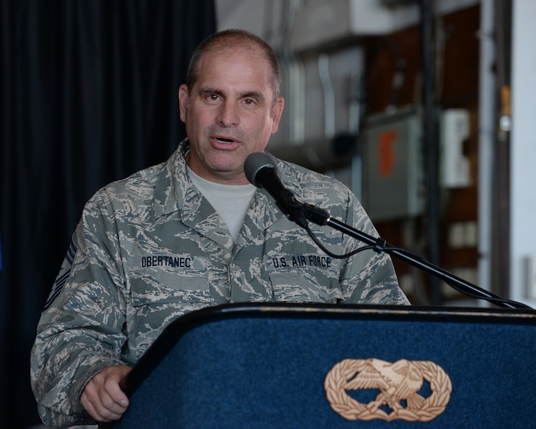 New Hampshire Air National Guard State Command Chief Master Sgt. David Obertanec speaks to those gathered during a change of authority ceremony at Pease Air National Guard Base, N.H., Aug. 9, 2015.  During this ceremony outgoing N.H. ANG State Command Chief Master Sgt. Matthew Collier relinquished authority to Obertanec. (U.S. Air National Guard photo by Staff Sgt. Curtis J. Lenz)