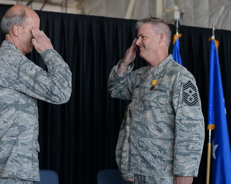 Outgoing New Hampshire Air National Guard State Command Chief Master Sgt. Matthew Collier salutes Maj. Gen. William N. Reddel III, N.H. National Guard adjutant general, during a change of authority ceremony at Pease Air National Guard Base, N.H., Aug. 9, 2015.  During the ceremony Collier relinquished authority to N.H. Command Chief Master Sgt. David Obertanec. (U.S. Air National Guard photo by Staff Sgt. Curtis J. Lenz)