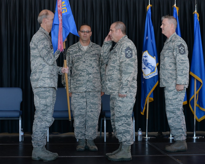 New Hampshire Air National Guard State Command Chief Master Sgt. David Obertanec salutes the N.H. National Guard Adjutant General Maj. Gen. William N. Reddel III during a change of authority ceremony at Pease Air National Guard Base, N.H., Aug. 9, 2015.  During the ceremony Chief Master Sgt. Matthew Collier relinquished authority to the Chief Master Sergeant David Obertanec. (U.S. Air National Guard photo by Staff Sgt. Curtis J. Lenz)