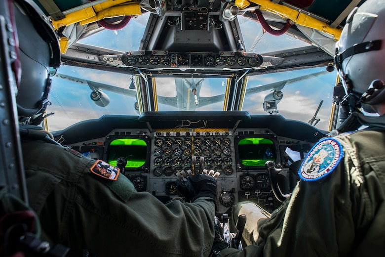 A B-52H Stratofortress pilot and copilot practice an aerial refueling with a KC-135 Stratotanker over Barksdale Air Force Base, Louisiana. The B-52 is assigned to the Air Force Reserve Command's 307th Bomb Wing, which hosts the only schoolhouse where Reserve and Active Duty aircrew learn to fly the B-52. (U.S. Air Force photo by Master Sgt. Greg Steele/Released)