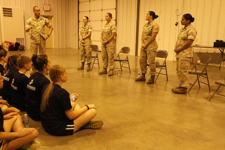 Sgt. Maj. Christopher A. Farrell, Marine Corps Recruiting Station Kansas City sergeant major, speaks to female poolees before turning the discussion over to a panel of female Marines of different ranks and MOSes during RS Kansas City's all-hands female pool function at Camp Clark in Nevada, Mo., Aug. 7, 2015.