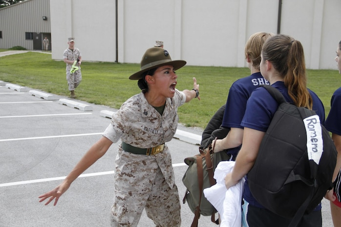 Sergeant Rosario Battiest, a Company N, 4th Recruit Training Battalion, Marine Corps Recruit Depot Parris Island drill instructor, instructs a poolee to reach the proper volume in repsonse to a question during Marine Corps Recruiting Station Kansas City's all-hands female pool function at Camp Clark in Nevada, Mo., Aug. 7, 2015.