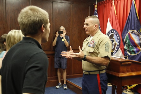 Sergeant Major Bryan B. Battaglia, Senior Enlisted Advisor to the Chairman of the Joint Chiefs of Staff, speaks to applicants at the Kansas City Military Entrance Processing Station in Kansas City, Mo., Aug. 5, 2015. Battaglia spoke of how every person who walks through MEPS is starting on a journey that will change their lives forever.