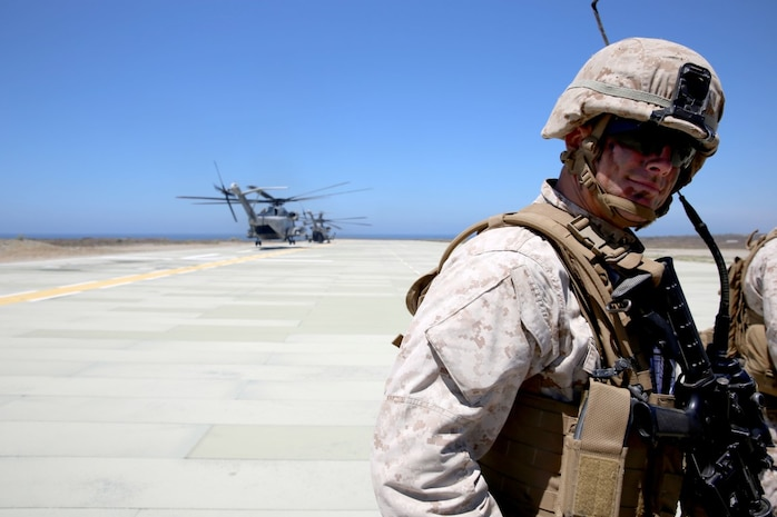 First Lt. Walter Graves II, a platoon commander with 3rd Battalion, 5th Marine Regiment, 1st Marine Division, waits for communication from his radio operator before conducting a helicopter raid as part of the Marine Corps Combat Readiness Evaluation (MCCRE), aboard Marine Corps Base Camp Pendleton, Calif., Aug. 4, 2015. The MCCRE is used evaluate the operational readiness of a designated unit. (U.S. Marine Corps Photo by Cpl. Demetrius Morgan/RELEASED)