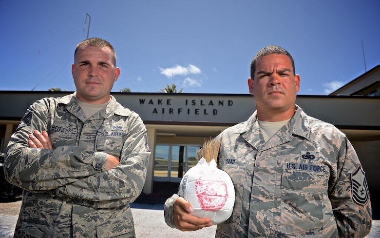U.S Air Force Tech. Sgt. Joshua Reitz, left and Master Sgt. Yusef Saad, both contracting officers with Detachment 1, Pacific Regional Support Center, stand in front of the passenger terminal at Wake Island Airfield, July 21, 2015. A small team with four Airmen of Det. 1 supervises contractor operations and ensures missions success on the remote atoll in the Pacific. (U.S. Air Force photo by Staff Sgt. Alexander W. Riedel/Released)