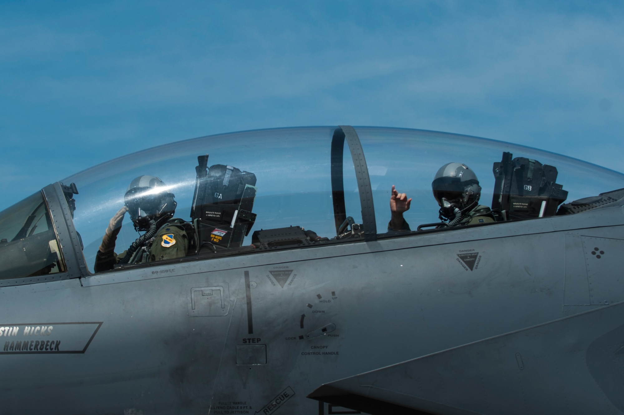 Lt. Col. Paul Hibbard, a 333rd Fighter Squadron instructor pilot, and Capt. Justin Thompson, a 333rd FS pilot, signal their crew chief as they taxi to the runway, July 22, 2015, at Seymour Johnson Air Force Base, N.C. After flying in operational squadrons for most of his career, Hibbard now instructs F-15E Strike Eagle aircrew on the intricacies of operating the aircraft. (U.S. Air Force photo/Airman Shawna L. Keyes)
