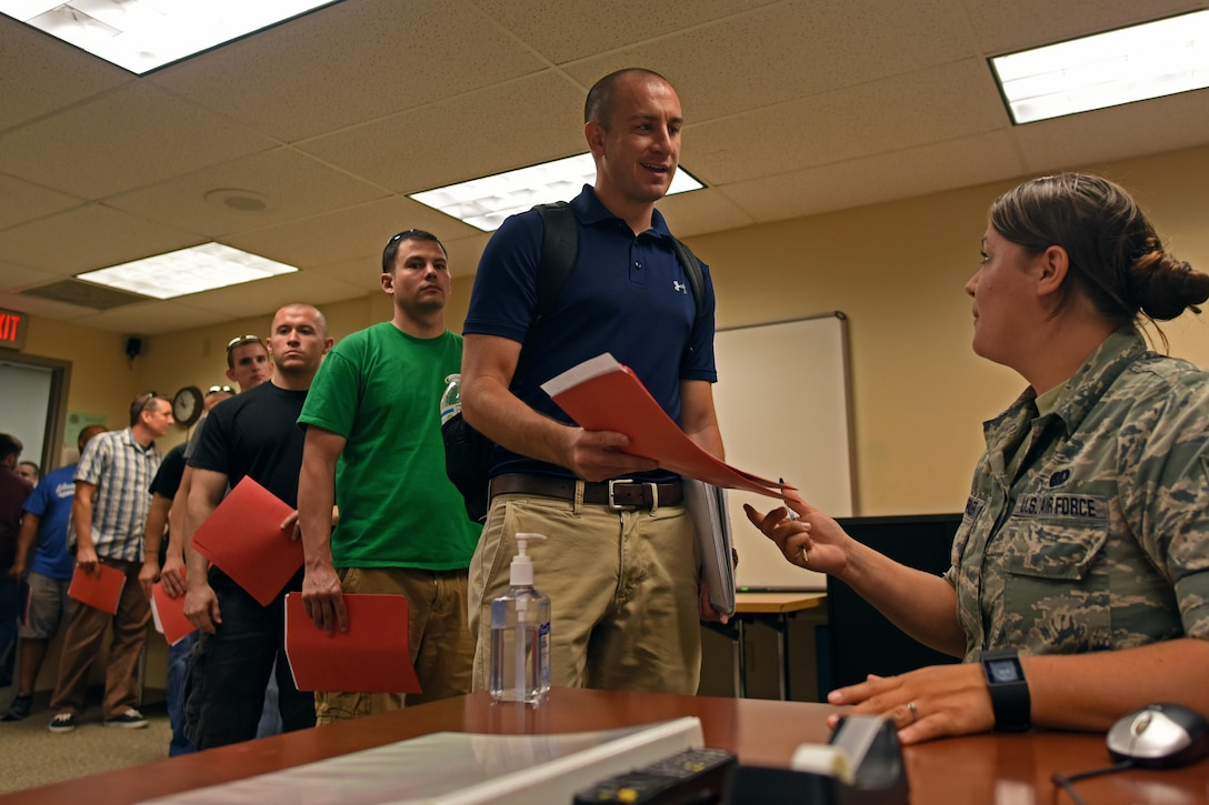 Senior Airman Bethany Trona-Farler, 121st Air Refueling Wing recruiting assistant, speaks with members of the Individual Ready Reserve about opportunities in the Ohio Air National Guard during a muster held July 31, 2015, at Rickenbacker Air National Guard Base, Ohio. IRR members are veterans that have time remaining on their statutory military service obligation of eight years and are required to participate in an annual screening until their remaining service time is completed. (U.S. Air National Guard photo by Airman Ashley Williams)