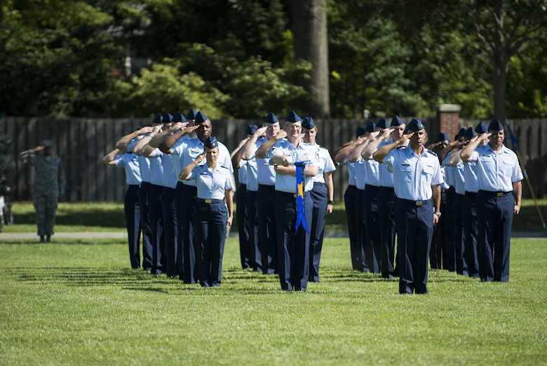 Airmen assigned to Headquarters Air Mobility Command, located at Scott Air Force Base, Ill., stand in formation during the AMC change of command ceremony Aug. 11, 2015. Gen. Carlton D. Everhart II assumed command of AMC from Gen. Darren W. McDew, who will be the new commander of U.S. Transportation Command. (U.S. Air Force photo/Staff Sgt. Clayton Lenhardt)