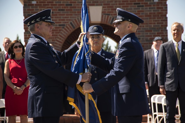 Chief of Staff of the Air Force Gen. Mark A. Welsh III passes the Air Mobility Command guidon to Gen. Carlton D. Everhart II during the AMC change of command ceremony at Scott Air Force Base, Ill., Aug. 11, 2015. Everhart is the 12th commander of AMC since its activation June 1, 1992. (U.S. Air Force photo/Senior Airman Jake Eckhardt)