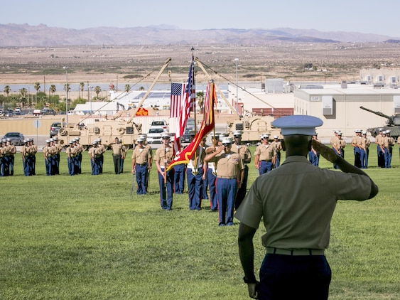 Marines salute during the playing of the National Anthem at a retirement ceremony for 1st Sgt. Nelson A. Hidalgo, Company A First Sergeant, 1st Tanks, at Lance Cpl. Torrey L. Gray Field, Aug. 7, 2015. Hidalgo retired after 20 years of service in the Marine Corps. (Official Marine Corps photo by Pfc. Levi Schultz/Released)